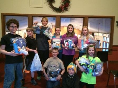 St. Christopher's 5th and 6th Grade Religious Education Class with the Welcome Kits they made.