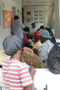 Patients wait on the clinic porch to be seen.